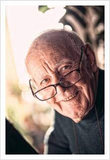 senior man wearing glasses and smiling
